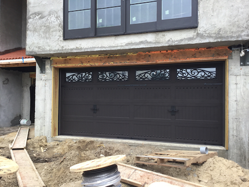 Wrought iron garage door installation